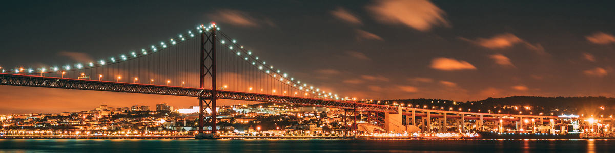 Lisbon at night, Photo by Fulvio Ambrosanio on Unsplash