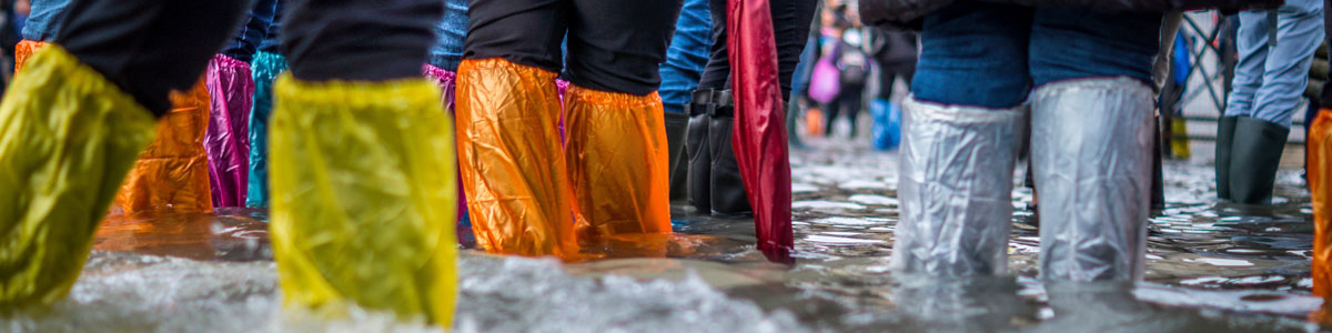 People in flood water, Photo by Jonathan Ford on Unsplash
