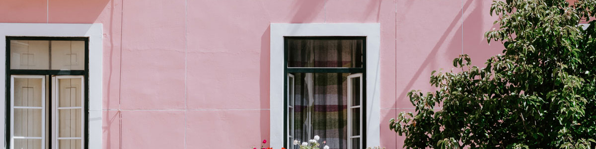 Pink building in Lisbon, photo by jessica arends on Unsplash